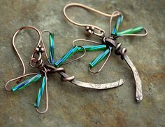 Wire wrapped Dragonflies! Those tube beads add just the right amount of iridescence.
