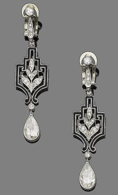 """A pair of art deco diamond and enamel pendent earrings, circa 1925. Each old brilliant and single-cut diamond surmount suspends a single-cut diamond foliate motif within a black enamel openwork geometric plaque, and terminates in a pear-shaped diamond drop, pear-shaped diamonds, approx. 3.30cts total, length 5.6cm."" by corrine"