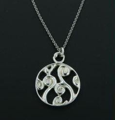 Fiddlehead Fern Pendant: a stylized sterling silver pendant showing fiddlehead ferns just emerging in springtime $150.