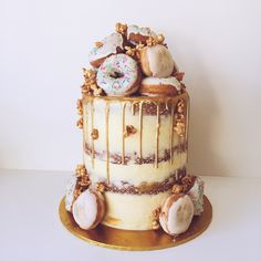 Donut cake with gold drip by Peaches & Cream Desserts