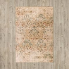 Lend a touch of pattern to your dining room or den ensemble with this Aminata Champagne/Green Area Rug, featuring a scrolling floral motif and faded details for timeworn appeal.