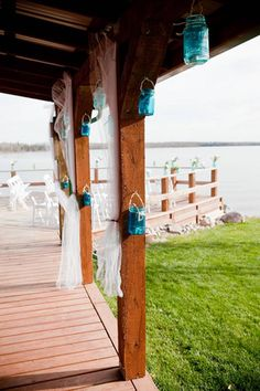 Real Weddings: Cara & Ken's Cabin Wedding On The Lake - I like the blue mason jars with tea lights