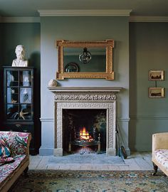 #Jambfireplace with #Globelanterns in the reflection of the #Antiquemirror all…
