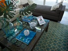 A smart tablet enables the homeowner to control TV covers, select TV stations and whole-house audio, monitor security camera activity, and control home security within the comfort of the living room. Bedroom Pictures, Living Room Pictures, Living Room Sets, Home Living Room, Tv Covers, Brown Color Schemes, Audio Room, Kitchen Pictures, Coastal Living