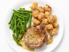 Get Food Network Kitchen's Lemon Garlic Pork Chops with Parmesan Tater Tots Recipe from Food Network