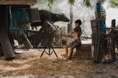 Rural children playing violin at countryside, - Rural children playing violin with fraind at countryside,Playing music is the relaxation of rural children in Asia.