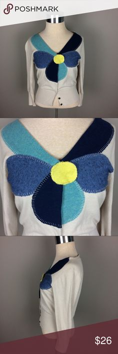 Anthropologie Field Flower Flower cardigan sweater Condition: Preowned, no holes or stains. Normal wear from washing and wearing  Color: cream with yellow and shades of blue  Measurements: Size medium Underarm to underarm is approximately  17 inches across.  Length from back of neck to bottom of hem is approximately 19 1/2 inches. May fit cropped at waist.   Materials: see photo of tag Field Flower Sweaters Cardigans