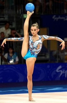 Rhythmic gymnast with ball. Okay cheerleaders...since you think cheering is a sport let's see you do this!