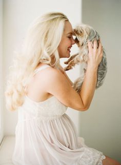 sweet maternity photo with a puppy
