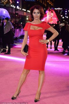 Red-dy to party: Amy Childs looked sensational in a scarlet cut-out dress at the premiere of How To Be Single in London on Tuesday