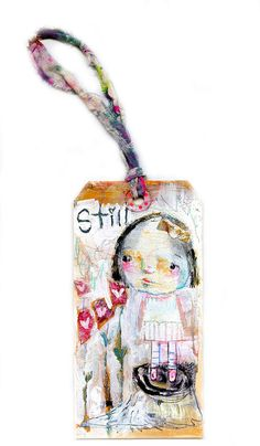 Still, Happy Moments is an mixed media art tag. Constructed with stamping, marker, paint and ribbon. It measures 3 x 6    Comes signed and dated on the back.