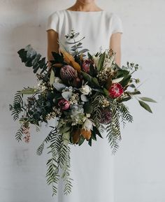 Oversized, untamed and packed with gorgeous natives - this incredible bouquet by @_thesecretgardenn_ is everything we love in a bouquet. If you missed Chris & Anneke's modern Townsville wedding, be sure to get your floral fix over on the homepage. @sbcreativeco_