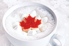Canadian Hot Chocolate - Add a cute, sparkly maple leaf garnish, and a simple mug of white hot chocolate becomes the perfect beverage for an Olympic cheering session or while watching the fireworks on Canada Day! Canadian Dishes, Canadian Food, Canadian Recipes, Canadian Cuisine, Hot Chocolate Recipes, How To Make Chocolate, Chocolate Party, Canada Holiday, White Dishes