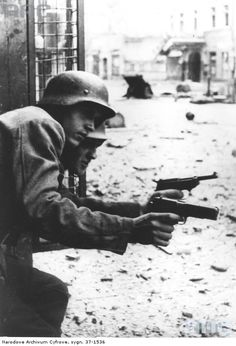 Nearest pistol is a Pistolet ViS wz. 35 and the other is a Walther P38. August 2, 1944