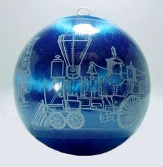 """Royal Blue Satin 3 1/4"""" Ball Christmas Tree Ornament with a Train Engine decorated plastic cover, white plastic ring hanger. Labeled Merry Christmas, Hummelwerk 1981."""