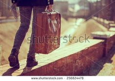 Urban young girl, walking down the street, carrying suitcase and a map. - stock photo