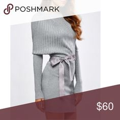 Women's knit dress with sash Pretty batwing light gray dress with long sleeves and a bow knot sash. 100% polyester. Crew neck. Fits true to size. Length- minidress Dresses Mini