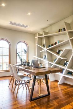 White Modern Study Room With Recessed Lighting And Abstract Bookshelf Design Wooden Floors