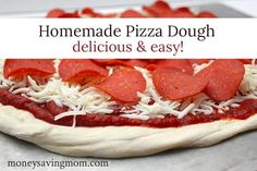 Homemade Pizza in Less Than 30 Minutes -- best and easiest pizza dough recipe.  *(made this and it was quick and easy. It ripped a bit when the kids were spreading it out on the pan)* mcbd