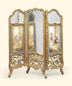 A FRENCH SEVRES-STYLE PORCELAIN-MOUNTED GILTWOOD THREE PANEL SCREEN OF LOUIS XV STYLE, LATE 19TH CENTURY Each section set with a bevelled glazed panel, the plaques painted with courting couples in a landscape, the reverse set with upholstered reserves 55 in. (139.5 cm.) high; 52 in. (132 cm.) wide