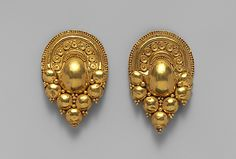 Gold earrings Period: Late Classical Date: 4th–early 3rd century B.C. Culture: Etruscan Medium: Gold Dimensions: Other (.1): 2 1/8 in. (5.4 cm) Other (.2): 2 in. (5.1 cm)
