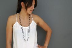 I like the length of this necklace. Steel and silver.