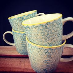 dainty blue and yellow mugs