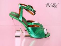 1960s 1960 s Metallic Green Lucite Sky High Heels These amazing vintage high heels are very rare and so high they are considered vintage fetish shoes The metallic green leather is gorgeous and shimmery the ankle straps are sturdy and have an adjustable metal buckle The clear lucite heels are sky high but what else would you expect from the famous Fredericks of Hollywood 1457 |Green Heels|