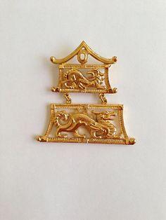 Monet GoldTone Pagoda Dragon Brooch by MtLaurelTreasures on Etsy, $50.00