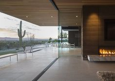 Architecture: Breezy Open Living Area Design With White Limestone Flooring And Modern Glass Fire Place Also Multi Slide Glass Door Outdoor Patio Furniture Set: Single Storey Hillside Residence in Paradise Valley, Arizona Rammed Earth Homes, Rammed Earth Wall, Paradise Valley, Haus Am Hang, Architecture Résidentielle, Sustainable Architecture, Hillside House, Open Living Area, Living Spaces