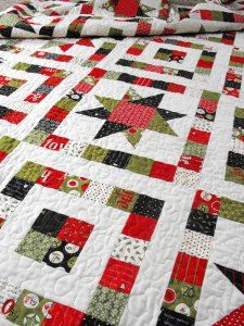 This looks like a well balanced Christmas quilt that I can use my jelly roll for.
