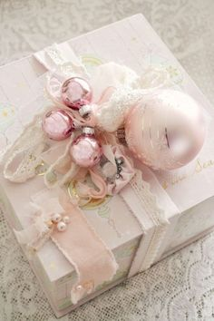 pastel pink ornaments can be cool gift toppers for winter holidays