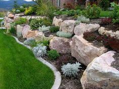 Staggered large rock retaining wall