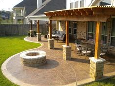 Pergola, Patio, Fire pit. This continuation of the back patio with the addition of the pergola is kind of what I want in our back yard. I dont want the curved area where that fire pit is though. A fire pit will be separate and in its own spot... #pergolafirepitideas