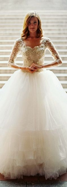 Tulle gown with beaded sleeved top.