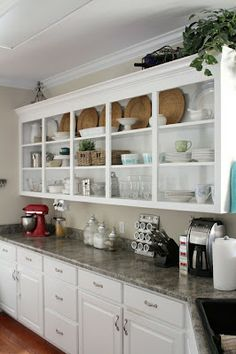 Trim out cabinets to look like built-in furniture. Just beachy: Have ...