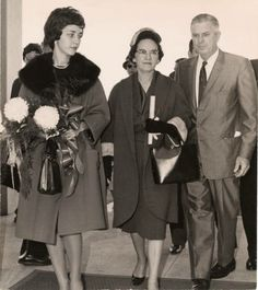 1961 - Dr. Wayne Cusic, President of McNeese, escorts Mrs. Lether E. Frazar and her daughter into the new Frazar Memorial Library.  Historic Photographs of Southwest Louisiana