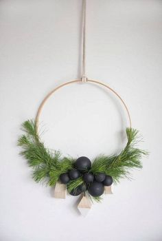 holiday wreath ideas white wall with hoop wreath and black ornaments