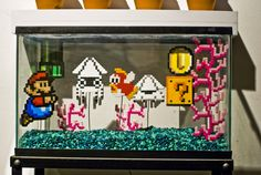Clever and cute :D a fishtank made into a mario water scene, using perler beads.