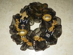 I love football, it is a religion down here. We all have our favorite teams, As women, we like to display our team spirit thru decor. My choice is decomesh wreaths, simple to make and elegant to display.