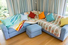 Corner sofa covered in quilts