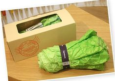 """Vegetabrella"" by Yurie Mano is an umbrella that looks like a head of lettuce when folded. It is as green and wrinkly as a fresh head of lettuce. Even the cover of the umbrella is designed to look like a lettuce. The color changes to greenish yellow when unfolded."