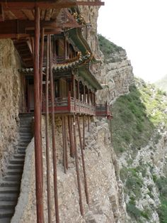 Monastery in China high in the mountains. I would venture to guess they don't get menus slipped under their door.