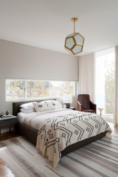 Modern Bedroom by DISC Interiors One of the keys is the grass cloth, a material Dick says gives the room definition and quietly grounds it.