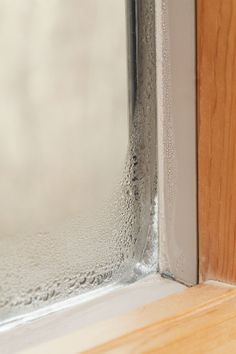 Condensation on windows is more than a pane—it could cost you thousands in home repair costs. Basement Windows, Wood Windows, Custom Windows, House Windows, Wood Window Sill, Interior Window Sill, Window Casing, Window Condensation, Leaking Basement