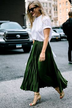 Green pleated skirt  plain white top  gold shoes ... 1d66bcfef9f