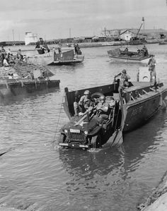 Waterproofed jeep rolling off LCV (Landing Craft, Vehicle) at Fedala, Morocco harbor during Operation TORCH, 8 November 1942
