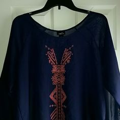 Navy Blue Sheer Rue 21 Top Navy blue sheer rue 21 Blouse with coral design on front. Tops Blouses