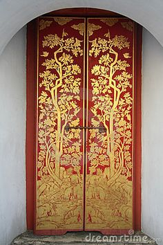 Thai painting door art in temple by Hommalai, via Dreamstime