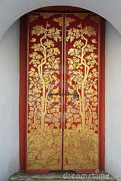 Thai painting door art in temple by Hommalai, via Dreamstime